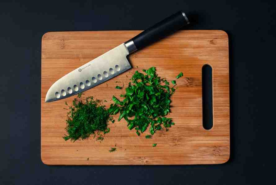 Chef's knife on a chopping board