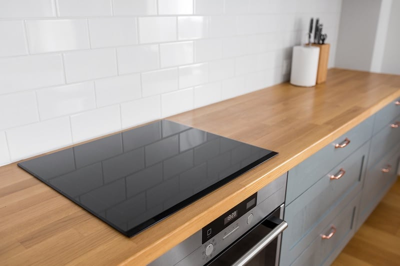 Induction hob in modern kitchen