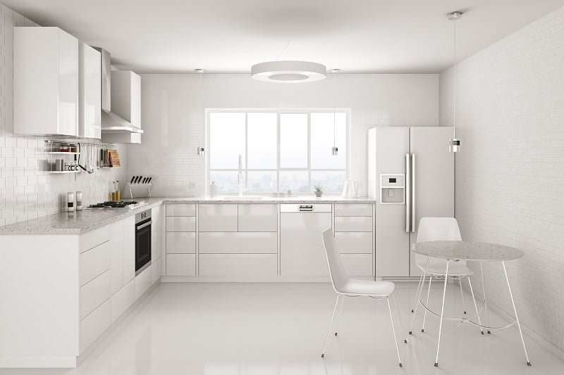Modern white kitchen with fridge and oven far apart