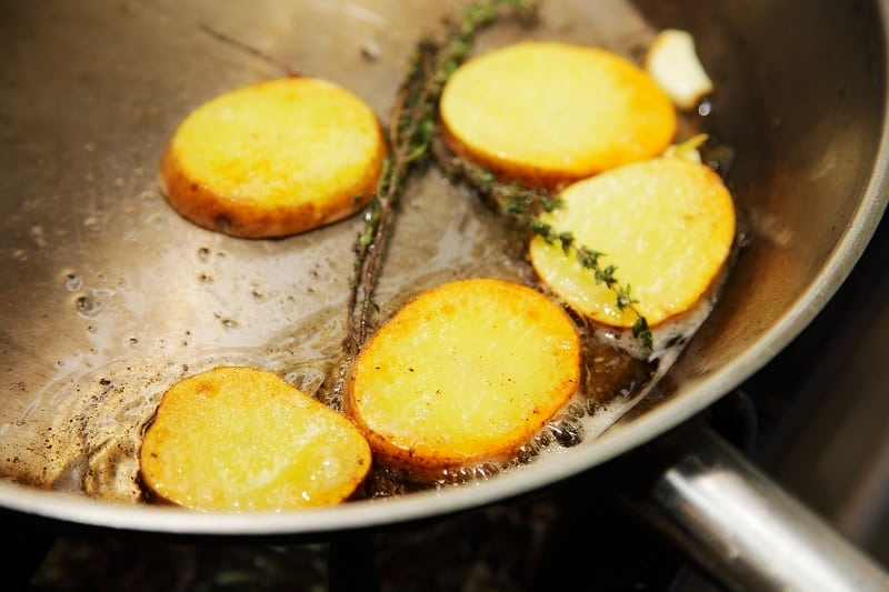 Roast potatoes cooking in a pan