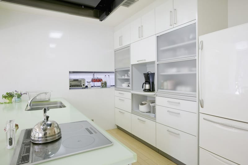 Modern white kitchen with hob and sink