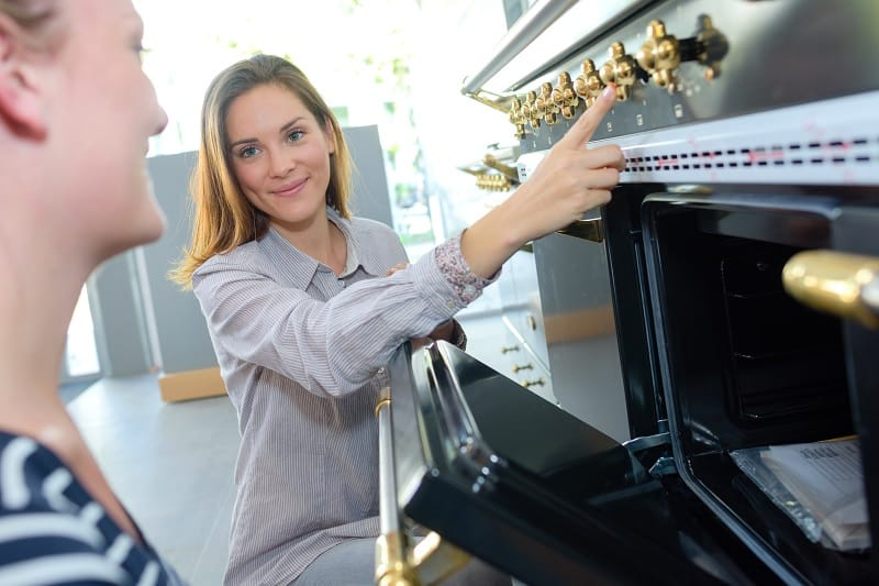 Woman pointing at range cooker