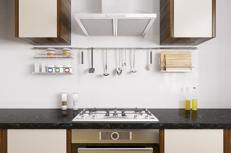 Kitchen countertop with hob and cooker hood