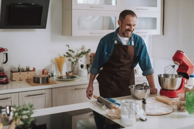 Man using stand mixer in home kitchen