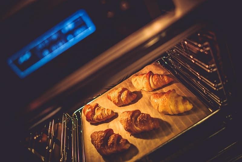 Croissants baking in oven
