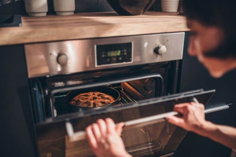 Woman Checking the Oven